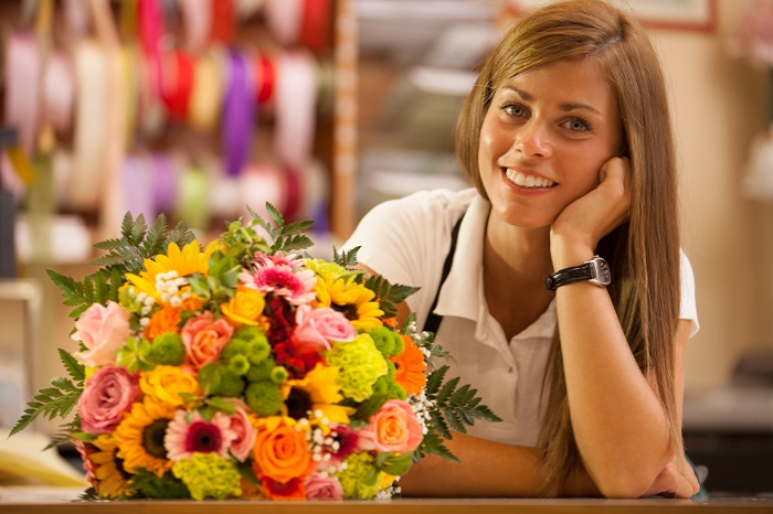 Beautiful smiling florist with colorful bouquet Los Angeles