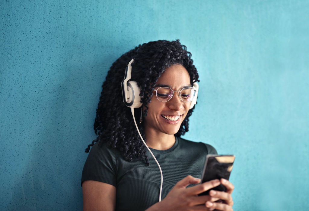 girl playing music on her android phone
