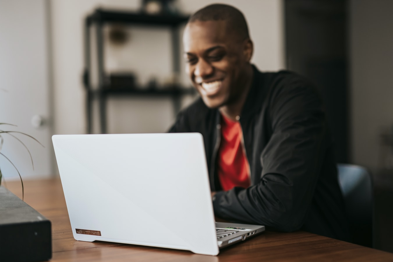 man using laptop happily