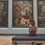 sitting in front of art