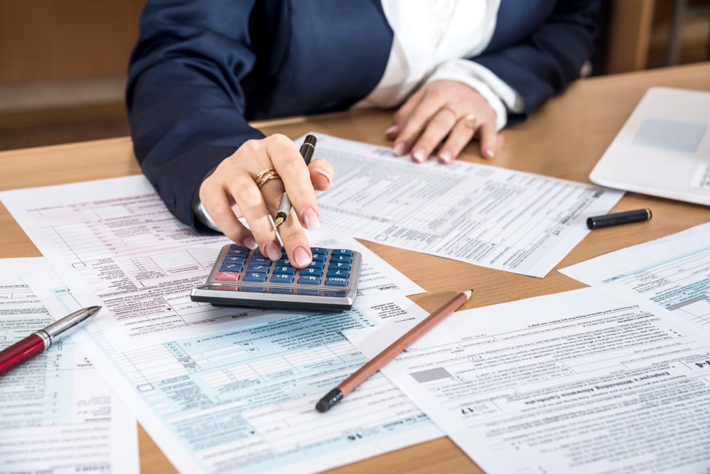 Woman filling US 1040 tax form 2018 year