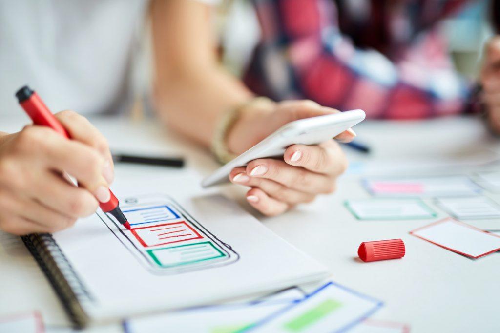 designer creating mobile app prototype