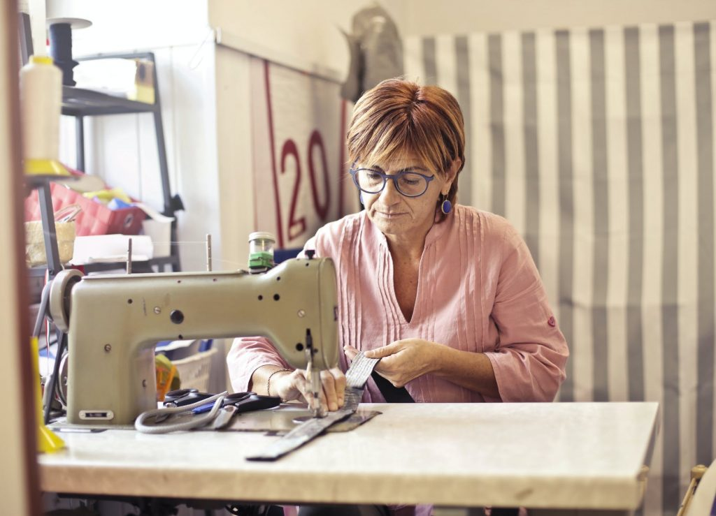 a lady doing stitches