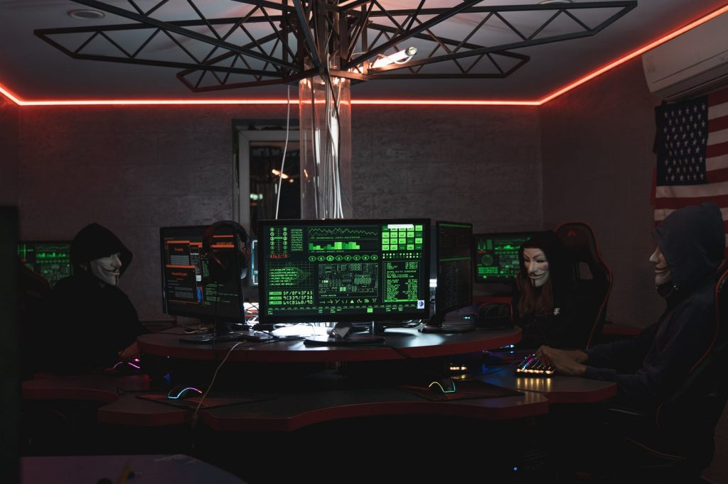 people wearing masks and operating computers