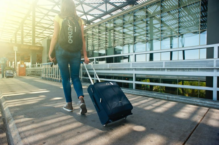 a girl with a traveling bag