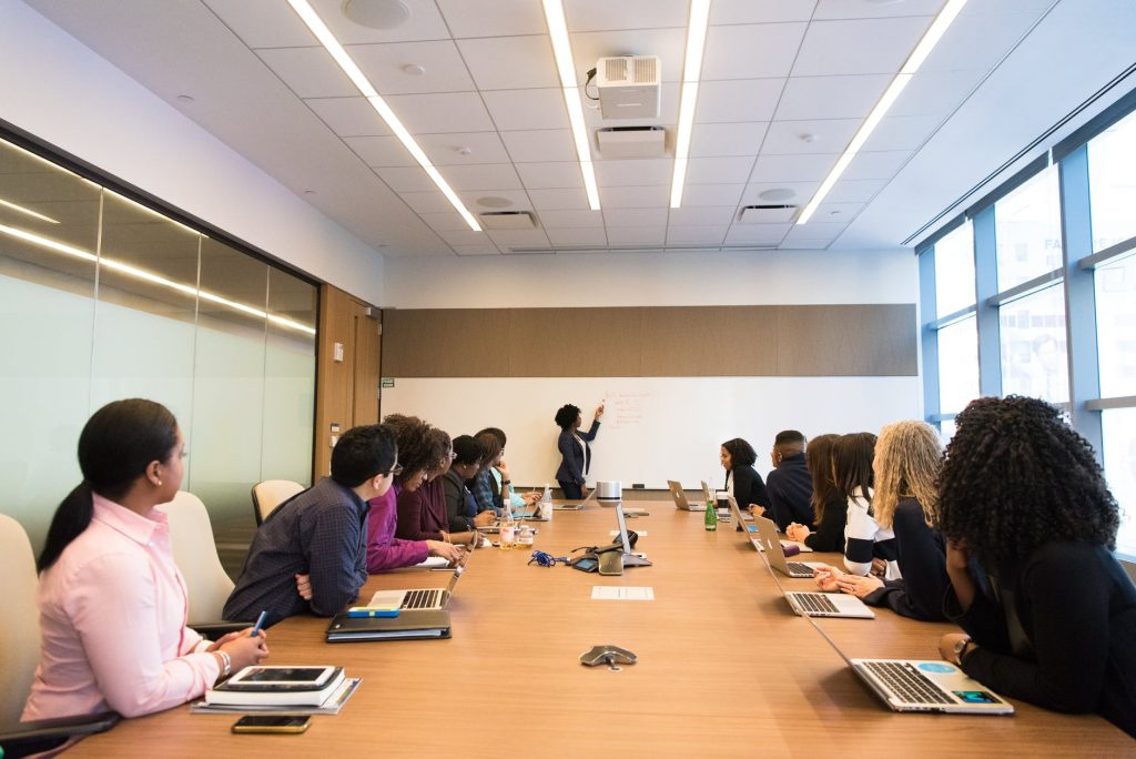 a group of people inside a conference room