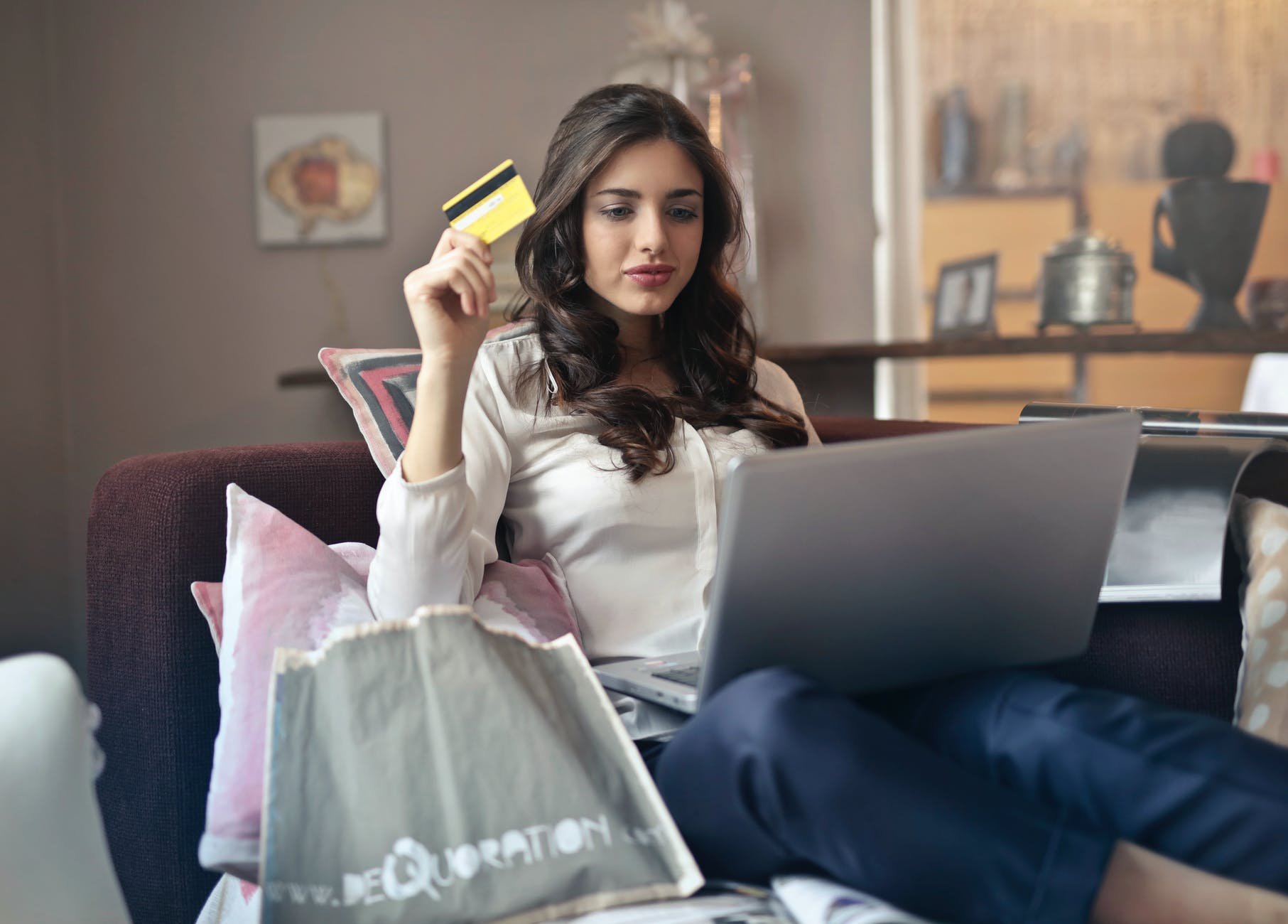 a lady holding a credit card
