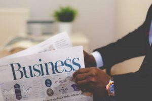 a man holding a newspaper