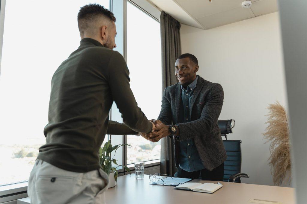 two men doing hand-shaking