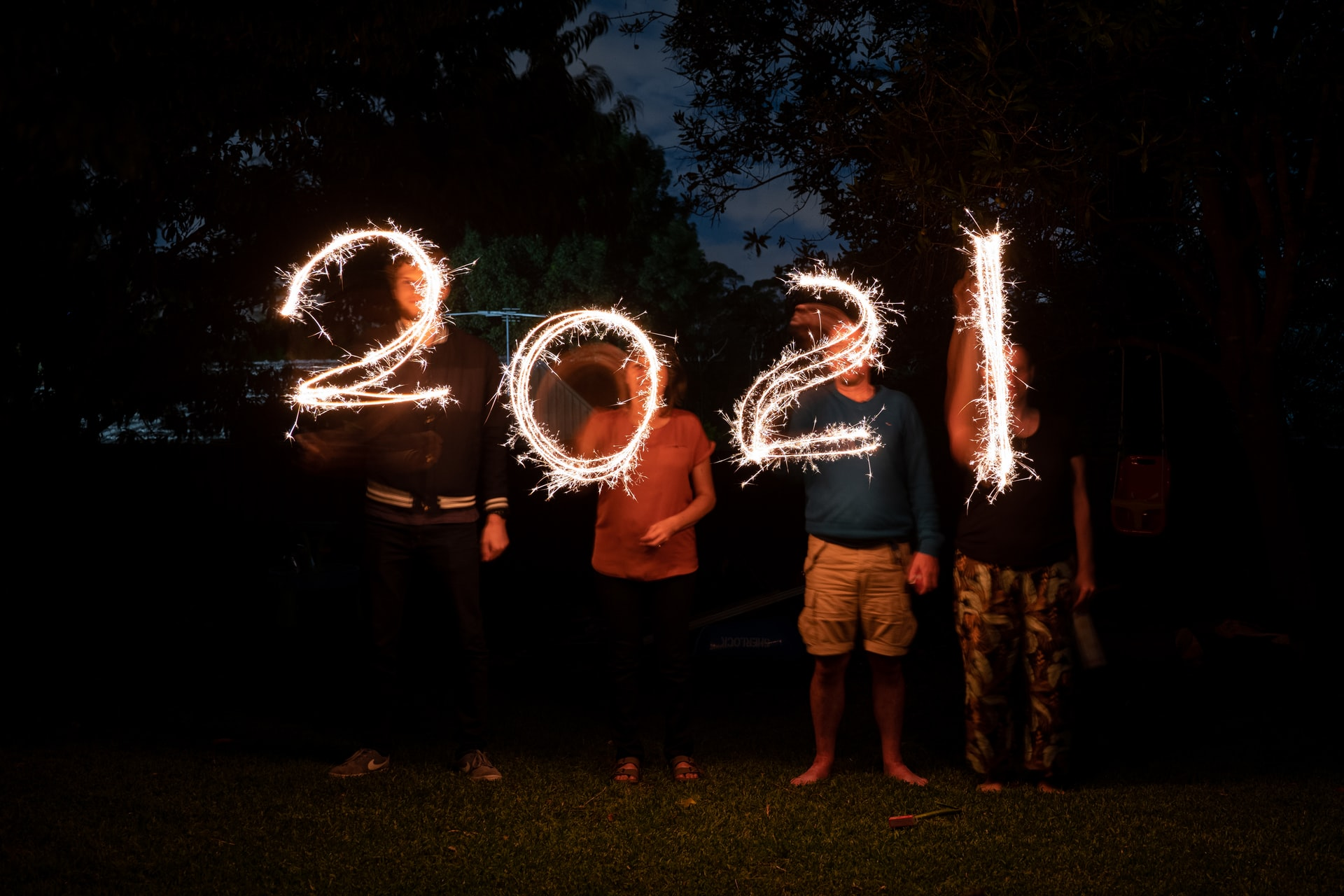 a group of people holding fireworks