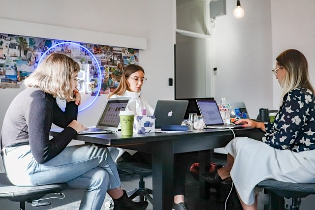 three ladies working in an office